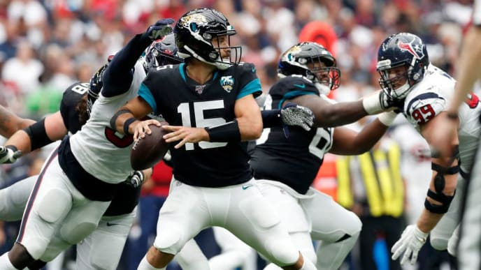 HOUSTON, TX - SEPTEMBER 15:  Gardner Minshew #15 of the Jacksonville Jaguars looks to pass under pressure by Whitney Mercilus #59 of the Houston Texans in the second half at NRG Stadium on September 15, 2019 in Houston, Texas.  (Photo by Tim Warner/Getty Images)