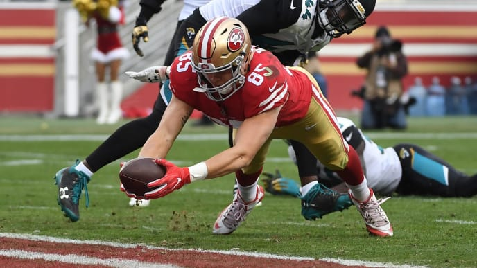 SANTA CLARA, CA - DECEMBER 24:  George Kittle #85 of the San Francisco 49ers dives into the end zone for a touchdown against the Jacksonville Jaguars during their NFL game at Levi's Stadium on December 24, 2017 in Santa Clara, California.  (Photo by Robert Reiners/Getty Images)