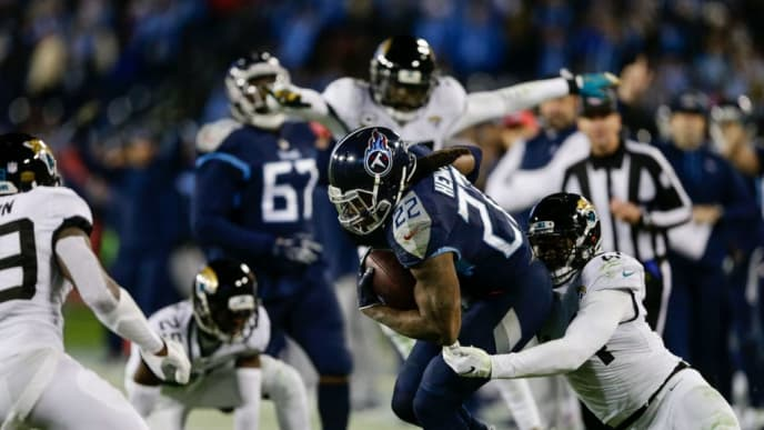 NASHVILLE, TN - DECEMBER 6: Derrick Henry #22 of the Tennessee Titans runs with the ball while being tackled by Myles Jack #44 of the Jacksonville Jaguars during the fourth quarter at Nissan Stadium on December 6, 2018 in Nashville, Tennessee. (Photo by Silas Walker/Getty Images)