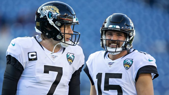 NASHVILLE, TN - NOVEMBER 24:  Nick Foles #7 and Gardner Minshew II #15 of the Jacksonville Jaguars talk before a game against the Tennessee Titans at Nissan Stadium on November 24, 2019 in Nashville, Tennessee.   (Photo by Wesley Hitt/Getty Images)