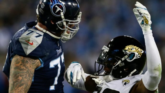 NASHVILLE, TN - DECEMBER 6: Jalen Ramsey #20 of the Jacksonville Jaguars falls after being confronted by Taylor Lewan #77 of the Tennessee Titans after tackling Derrick Henry #22 during the fourth quarter at Nissan Stadium on December 6, 2018 in Nashville, Tennessee. (Photo by Silas Walker/Getty Images)