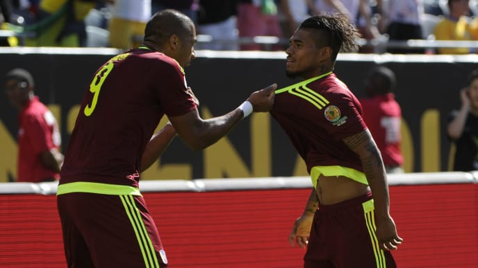 CHICAGO, ILLINOIS, USA - JUNE 05:  Josef Martinez #17 of Venezuela celebrates with Jose Salomon Rondon #9 after he scores a goal in the first half during a group C match between Jamaica and Venezuela at Soldier Field Stadium as part of Copa America Centenario US 2016 on June 05, 2016 in Chicago, Illinois, US. (Photo by Matt Marton/LatinContent via Getty Images)