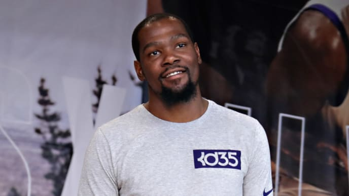 NEW YORK, NY - JULY 24:  Professional basketball player Kevin Durant speaks to students during the KD Build It and They Will Ball court ceremony on July 24, 2017 in New York City.  (Photo by Cindy Ord/Getty Images for Kevin Durant Charity Foundation)