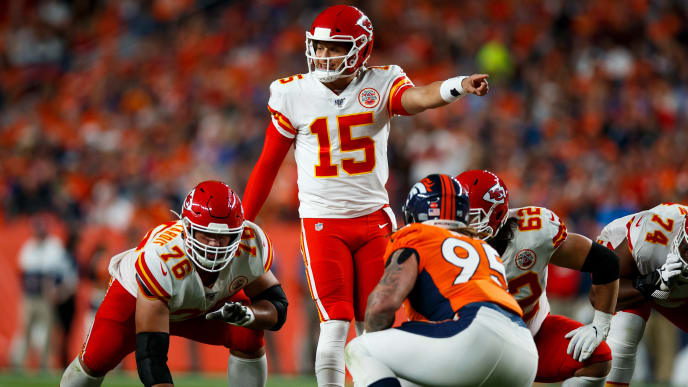 DENVER, CO - OCTOBER 17:  Quarterback Patrick Mahomes #15 of the Kansas City Chiefs signals against the Denver Broncos during the first quarter at Empower Field at Mile High on October 17, 2019 in Denver, Colorado. (Photo by Justin Edmonds/Getty Images)