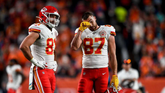 DENVER, CO - OCTOBER 17:  Blake Bell #81 and Travis Kelce #87 of the Kansas City Chiefs react as Patrick Mahomes #15 (not pictured) is tended to on the field after sustaining an injury in the second quarter of a game against the Denver Broncos at Empower Field at Mile High on October 17, 2019 in Denver, Colorado. (Photo by Dustin Bradford/Getty Images)