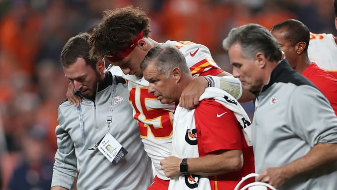 DENVER, COLORADO - OCTOBER 17: Quarterback Patrick Mahomes #15 of the Kansas City Chiefs is escorted off the field after an injury in the first half against the Denver Broncos in the game at Broncos Stadium at Mile High on October 17, 2019 in Denver, Colorado. (Photo by Matthew Stockman/Getty Images)