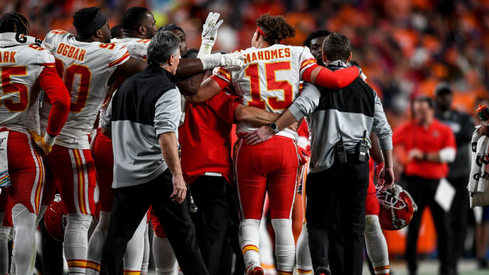 DENVER, CO - OCTOBER 17:  Patrick Mahomes #15 of the Kansas City Chiefs is helped off the field by trainers after sustaining an injury in the second quarter of a game against the Denver Broncos at Empower Field at Mile High on October 17, 2019 in Denver, Colorado. (Photo by Dustin Bradford/Getty Images)