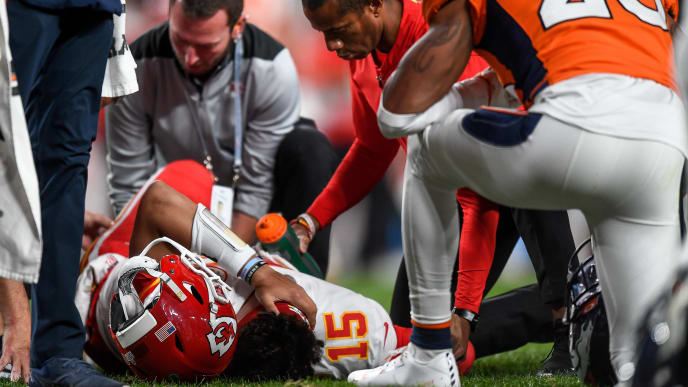DENVER, CO - OCTOBER 17:  Patrick Mahomes #15 of the Kansas City Chiefs is tended to by trainers after sustaining an injury in the second quarter of a game against the Denver Broncos at Empower Field at Mile High on October 17, 2019 in Denver, Colorado. (Photo by Dustin Bradford/Getty Images)