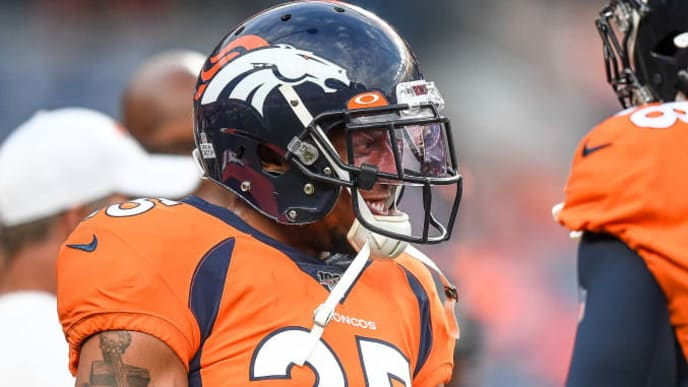 DENVER, CO - OCTOBER 17:  Chris Harris #25 of the Denver Broncos stands on the field as players warm up before a game against the Kansas City Chiefs at Empower Field at Mile High on October 17, 2019 in Denver, Colorado. (Photo by Dustin Bradford/Getty Images)