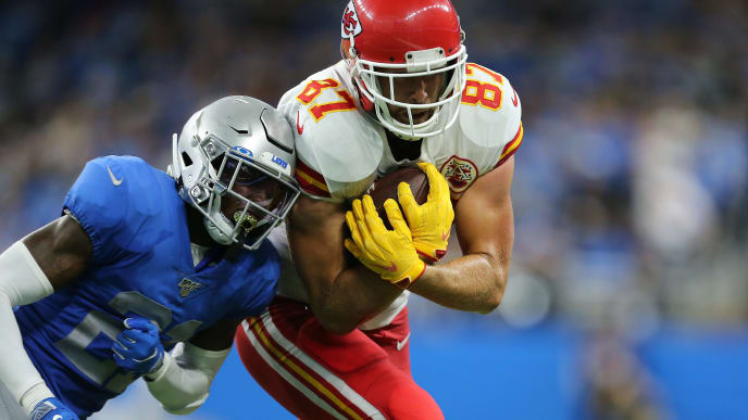 DETROIT, MI - SEPTEMBER 29: Travis Kelce #87 of the Kansas City Chiefs runs the ball after a catch and pushed out of bounce by Tracy Walker #21 of the Detroit Lions at Ford Field on September 29, 2019 in Detroit, Michigan. (Photo by Rey Del Rio/Getty Images)