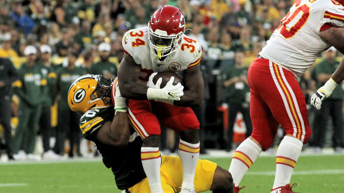 GREEN BAY, WISCONSIN - AUGUST 29:  Kingsley Keke #96 of the Green Bay Packers tackles Dakari Monroe #43 of the Kansas City Chiefs in the first quarter during a preseason game at Lambeau Field on August 29, 2019 in Green Bay, Wisconsin. (Photo by Dylan Buell/Getty Images)