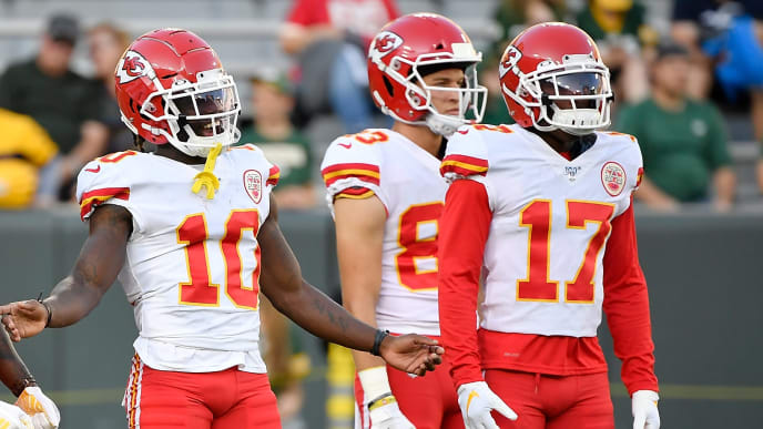 GREEN BAY, WISCONSIN - AUGUST 29:  Tyreek Hill #10, Mecole Hardman #17, and teammates of the Kansas City Chiefs warms up before a preseason game against the Green Bay Packers at Lambeau Field on August 29, 2019 in Green Bay, Wisconsin. (Photo by Quinn Harris/Getty Images)