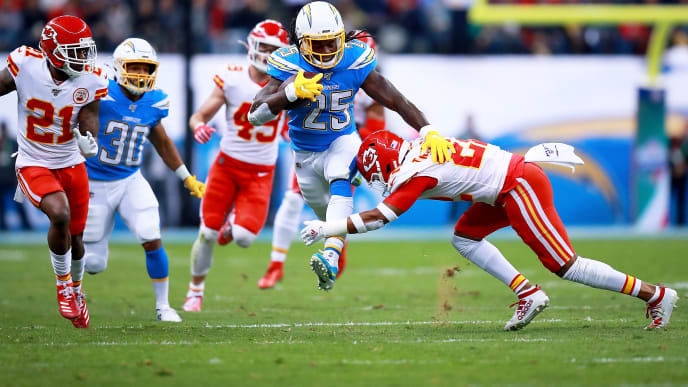 MEXICO CITY, MEXICO - NOVEMBER 18: Running back Melvin Gordon #25 of the Los Angeles Chargers  carries the ball against free safety Juan Thornhill #22 of the Kansas City Chiefs  during the game at Estadio Azteca on November 18, 2019 in Mexico City, Mexico. (Photo by Manuel Velasquez/Getty Images)