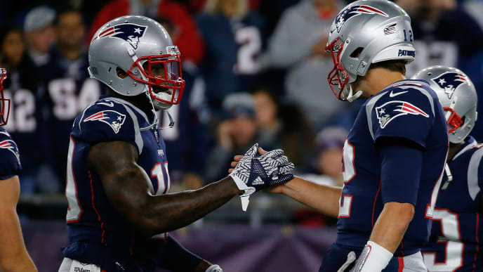 FOXBOROUGH, MA - OCTOBER 14: Tom Brady #12 of the New England Patriots interacts with Josh Gordon #10 of the New England Patriots before a game with the Kansas City Chiefs at Gillette Stadium on October 14, 2018 in Foxborough, Massachusetts. (Photo by Jim Rogash/Getty Images)