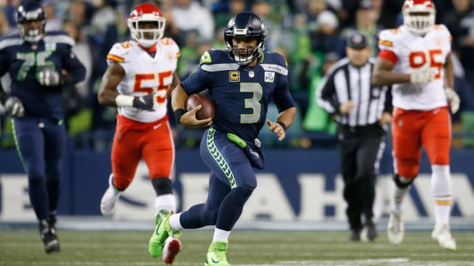 SEATTLE, WA - DECEMBER 23:  Quarterback Russell Wilson #3 of the Seattle Seahawks rushes for a first down during the first quarter of the game against the Kansas City Chiefs at CenturyLink Field on December 23, 2018 in Seattle, Washington.  (Photo by Otto Greule Jr/Getty Images)