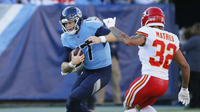 NASHVILLE, TENNESSEE - NOVEMBER 10: Quarterback Ryan Tannehill #17 of the Tennessee Titans rushes against Tyrann Mathieu #32 of the Kansas City Chiefs during the second half at Nissan Stadium on November 10, 2019 in Nashville, Tennessee. (Photo by Frederick Breedon/Getty Images)