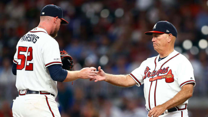 ATLANTA, GEORGIA - JULY 23:  Manager Brian Snitker #43 of the Atlanta Braves takes the ball from relief pitcher Wes Parsons #52 in the eighth inning during the game against the Kansas City Royals at SunTrust Park on July 23, 2019 in Atlanta, Georgia. (Photo by Mike Zarrilli/Getty Images)