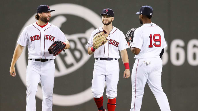BOSTON, MA - AUGUST 05:  Sam Travis #59, Andrew Benintendi #16, and Jackie Bradley Jr. #19 of the Boston Red Sox react after a victory over the Kansas City Royals at Fenway Park on August 5, 2019 in Boston, Massachusetts.  (Photo by Adam Glanzman/Getty Images)