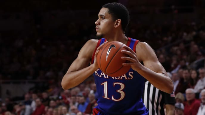 Kansas' Tristan Enaruna looks for an open pass in a game against the Iowa State Cyclones.