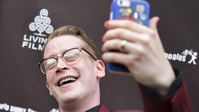 """HOLLYWOOD, CALIFORNIA - JUNE 03: Macaulay Culkin takes selfie the LA Premiere of Gravitas Ventures' """"Changeland"""" at ArcLight Hollywood on June 03, 2019 in Hollywood, California. (Photo by Rodin Eckenroth/Getty Images)"""