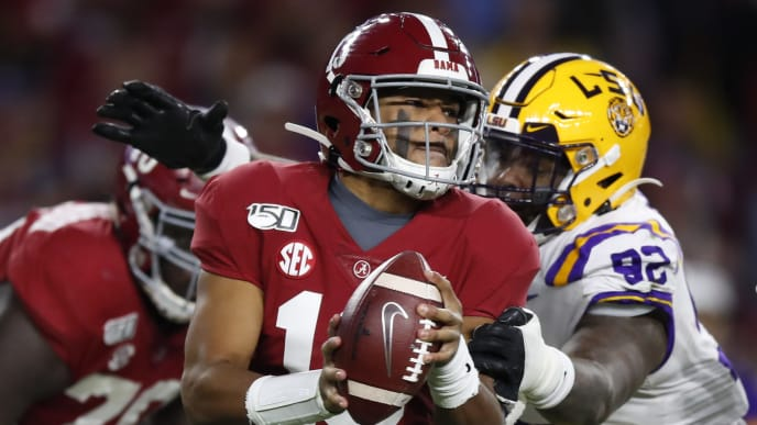 TUSCALOOSA, AL - NOVEMBER 09: Tua Tagovailoa #13 of the Alabama Crimson Tide is pressured by Neil Farrell Jr. #92 of the LSU Tigers during the second half at Bryant-Denny Stadium on November 9, 2019 in Tuscaloosa, Alabama. (Photo by Todd Kirkland/Getty Images)
