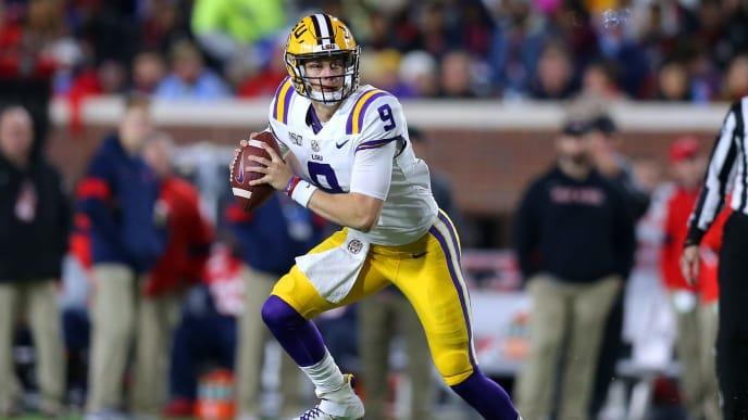 OXFORD, MISSISSIPPI - NOVEMBER 16: Joe Burrow #9 of the LSU Tigers runs with the ball during a game against the Mississippi Rebels at Vaught-Hemingway Stadium on November 16, 2019 in Oxford, Mississippi. (Photo by Jonathan Bachman/Getty Images)