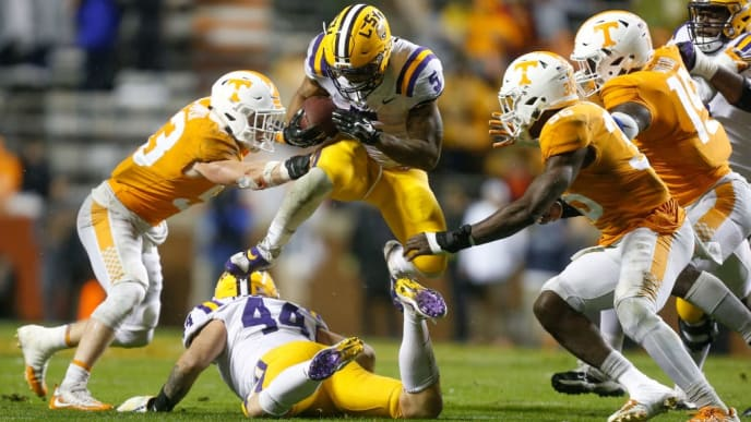 KNOXVILLE, TN - NOVEMBER 18:  Derrius Guice #5 of the LSU Tigers jumps through the defense against the Tennessee Volunteers during the second half at Neyland Stadium on November 18, 2017 in Knoxville, Tennessee.  (Photo by Michael Reaves/Getty Images)