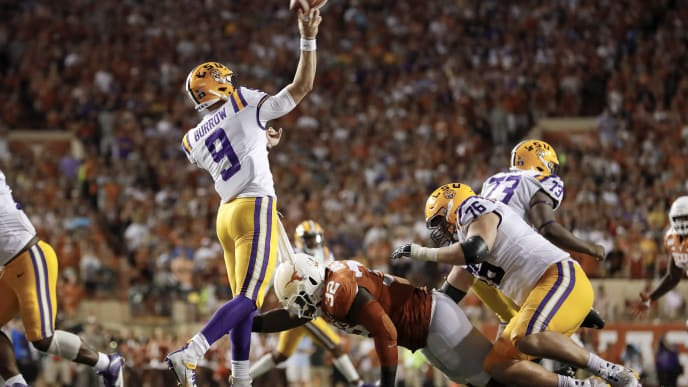 AUSTIN, TX - SEPTEMBER 07:  Joe Burrow #9 of the LSU Tigers throws a pass under pressure by Malcolm Roach #32 of the Texas Longhorns in the third quarter at Darrell K Royal-Texas Memorial Stadium on September 7, 2019 in Austin, Texas.  (Photo by Tim Warner/Getty Images)