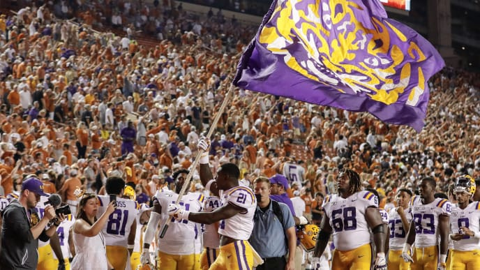 AUSTIN, TX - SEPTEMBER 07:  Kenan Jones #21 of the LSU Tigers celebrates with a flag after the game against the Texas Longhorns at Darrell K Royal-Texas Memorial Stadium on September 7, 2019 in Austin, Texas.  (Photo by Tim Warner/Getty Images)