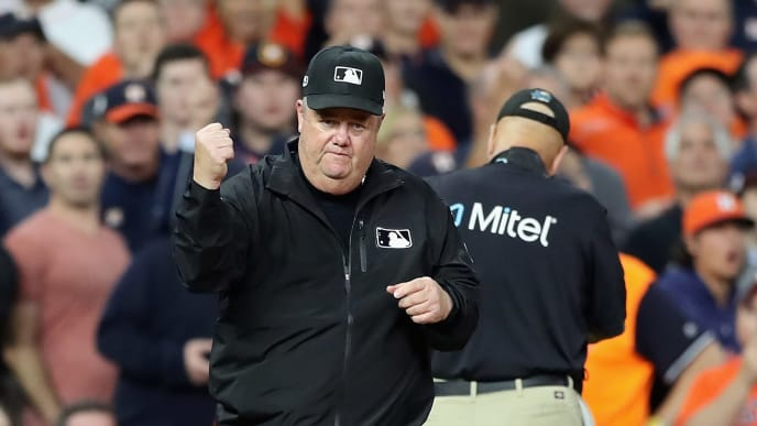 HOUSTON, TX - OCTOBER 17:  Umpire Joe West calls out Jose Altuve #27 of the Houston Astros (not pictured) on fan interference in the first inning during Game Four of the American League Championship Series between the Boston Red Sox and the Houston Astros at Minute Maid Park on October 17, 2018 in Houston, Texas.  (Photo by Elsa/Getty Images)