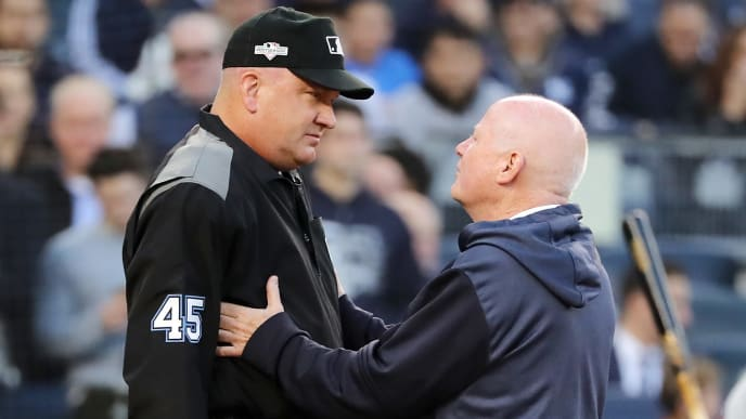 NEW YORK, NEW YORK - OCTOBER 15: New York Yankees trainer Steve Donahue checks on umpire Jeff Nelson after Nelson was hit by the ball in game three of the American League Championship Series between the Houston Astros and the New York Yankees at Yankee Stadium on October 15, 2019 in New York City. (Photo by Elsa/Getty Images)