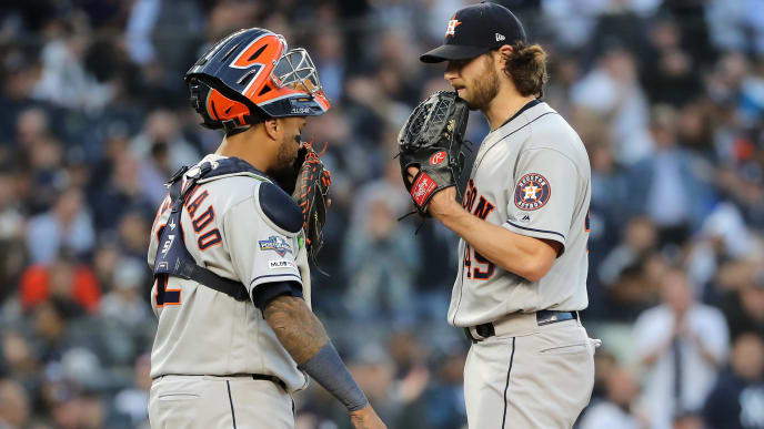 NEW YORK, NEW YORK - OCTOBER 15: Gerrit Cole #45 of the Houston Astros meets with Martin Maldonado #12 on the pitcher's mound during the fourth inning against the New York Yankees in game three of the American League Championship Series at Yankee Stadium on October 15, 2019 in New York City. (Photo by Elsa/Getty Images)