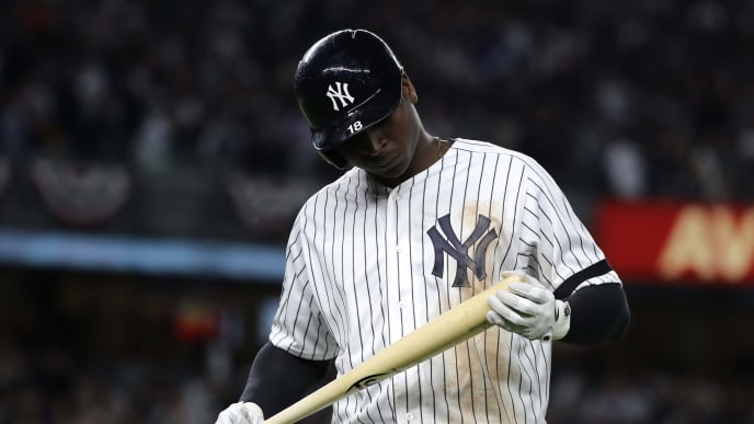 NEW YORK, NEW YORK - OCTOBER 15: Didi Gregorius #18 of the New York Yankees reacts after flying out during the fifth inning against the Houston Astros in game three of the American League Championship Series at Yankee Stadium on October 15, 2019 in New York City. (Photo by Elsa/Getty Images)