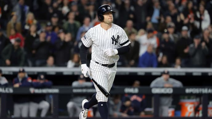 NEW YORK, NEW YORK - OCTOBER 17:  Brett Gardner #11 of the New York Yankees draws an RBI walk against the Houston Astros during the first inning in game four of the American League Championship Series at Yankee Stadium on October 17, 2019 in New York City. (Photo by Elsa/Getty Images)