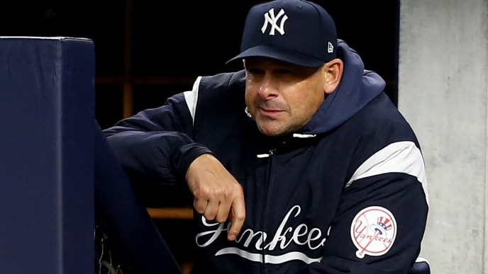 NEW YORK, NEW YORK - OCTOBER 18: Aaron Boone #17 of the New York Yankees looks on from the dugout against the Houston Astros in game five of the American League Championship Series at Yankee Stadium on October 18, 2019 in New York City. (Photo by Mike Stobe/Getty Images)