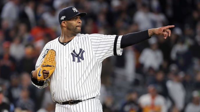NEW YORK, NEW YORK - OCTOBER 17:  CC Sabathia #52 of the New York Yankees reacts against the Houston Astros during the eighth inning in game four of the American League Championship Series at Yankee Stadium on October 17, 2019 in New York City. (Photo by Elsa/Getty Images)