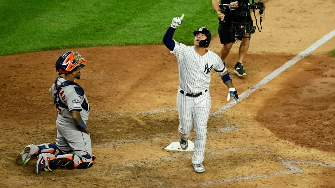 NEW YORK, NEW YORK - OCTOBER 15:  Gleyber Torres #25 of the New York Yankees celebrates his solo home run in eighth inning against the Houston Astros in game three of the American League Championship Series at Yankee Stadium on October 15, 2019 in the Bronx borough of New York City. (Photo by Emilee Chinn/Getty Images)