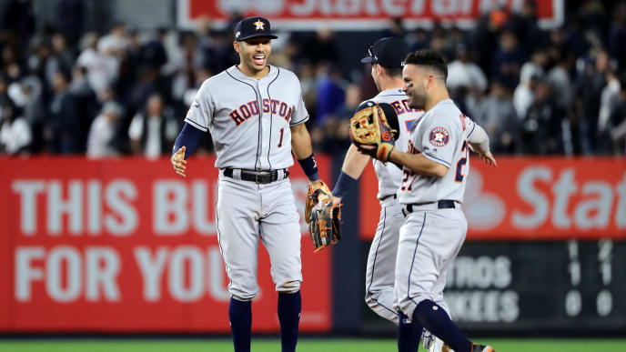 NEW YORK, NEW YORK - OCTOBER 15: Carlos Correa #1, Alex Bregman #2 and Jose Altuve #27 of the Houston Astros celebrate after defeating the New York Yankees 4-1 in game three of the American League Championship Series at Yankee Stadium on October 15, 2019 in New York City. (Photo by Elsa/Getty Images)