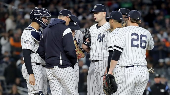 NEW YORK, NEW YORK - OCTOBER 18: Aaron Boone #17 of the New York Yankees talks with James Paxton #65 on the mound against the Houston Astros during the sixth inning in game five of the American League Championship Series at Yankee Stadium on October 18, 2019 in New York City. (Photo by Elsa/Getty Images)