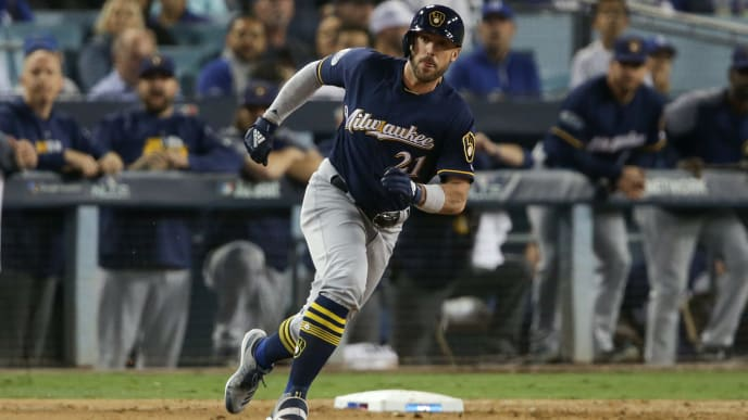 LOS ANGELES, CA - OCTOBER 15:  Travis Shaw #21 of the Milwaukee Brewers rounds first on his way to third after hitting a triple in the sixth inning against the Los Angeles Dodgers in Game Three of the National League Championship Series at Dodger Stadium on October 15, 2018 in Los Angeles, California.  (Photo by Jeff Gross/Getty Images)