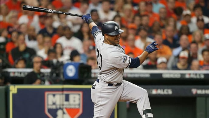 HOUSTON, TEXAS - OCTOBER 13: Edwin Encarnacion #30 of the New York Yankees strikes out during the second inning against the Houston Astros in game two of the American League Championship Series at Minute Maid Park on October 13, 2019 in Houston, Texas. (Photo by Bob Levey/Getty Images)