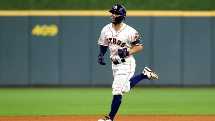 HOUSTON, TEXAS - OCTOBER 19:  Jose Altuve #27 of the Houston Astros rounds the bases after his walk-off two-run home run to win game six of the American League Championship Series 6-4 against the New York Yankees at Minute Maid Park on October 19, 2019 in Houston, Texas. (Photo by Bob Levey/Getty Images)