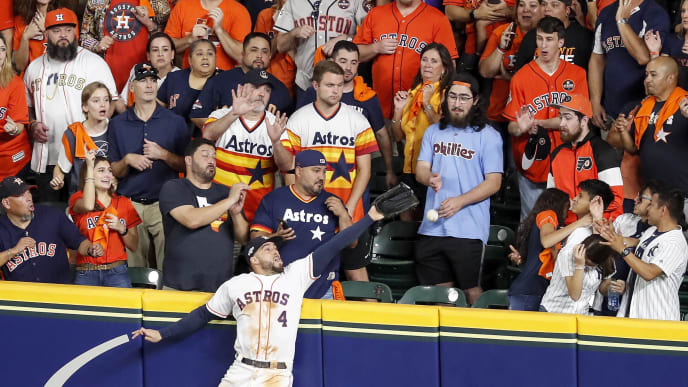 HOUSTON, TX - OCTOBER 19:  George Springer #4 of the Houston Astros attempts to catch a home run by DJ LeMahieu #26 of the New York Yankees in the ninth inning during Game Six of the League Championship Series at Minute Maid Park on October 19, 2019 in Houston, Texas.  (Photo by Tim Warner/Getty Images)