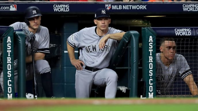HOUSTON, TX - OCTOBER 21:  Greg Bird #33, manager Joe Girardi #28 and Aaron Judge #99 of the New York Yankees look on from the dugout during the sixth inning against the Houston Astros in Game Seven of the American League Championship Series at Minute Maid Park on October 21, 2017 in Houston, Texas.  (Photo by Ronald Martinez/Getty Images)