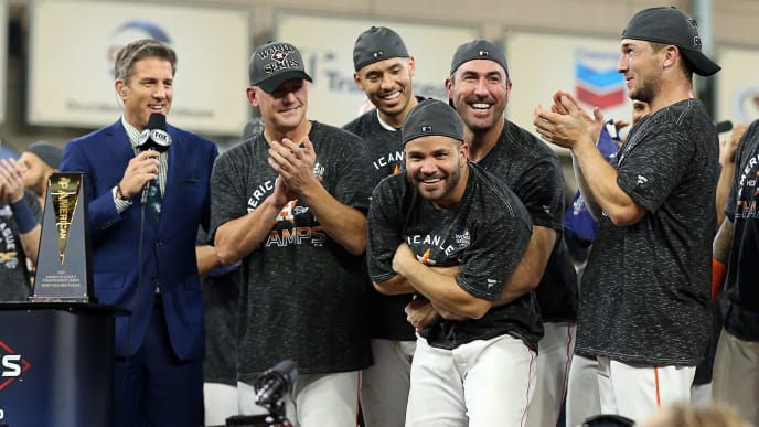 HOUSTON, TEXAS - OCTOBER 19: Justin Verlander #35 of the Houston Astros celebrates with Jose Altuve #27 and the rest of teammates after beating the New York Yankees in  Game 6 of the American League Championship Series at Minute Maid Park on October 19, 2019 in Houston, Texas. (Photo by Bob Levey/Getty Images)