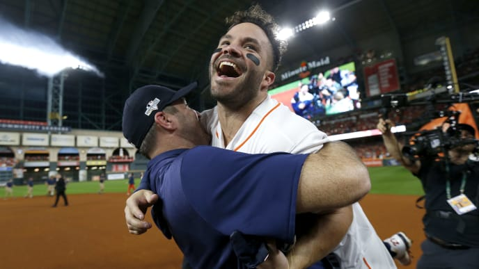 HOUSTON, TEXAS - OCTOBER 19:  Jose Altuve #27 of the Houston Astros is congratulated by his teammate Justin Verlander #35 following his ninth inning walk-off two-run home run to defeat the New York Yankees 6-4 in game six of the American League Championship Series at Minute Maid Park on October 19, 2019 in Houston, Texas. The Astros defeated the Yankees 6-4. (Photo by Elsa/Getty Images)