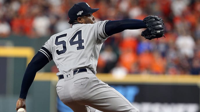 HOUSTON, TEXAS - OCTOBER 19:  Aroldis Chapman #54 of the New York Yankees pitches in the  ninth inning against the Houston Astros in Game 6 of the American League Championship Series at Minute Maid Park on October 19, 2019 in Houston, Texas. (Photo by Bob Levey/Getty Images)