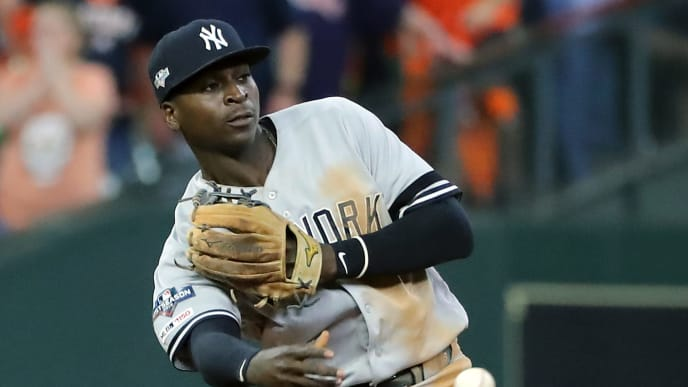 HOUSTON, TEXAS - OCTOBER 19:  Didi Gregorius #18 of the New York Yankees throws out the runner at second base against the Houston Astros during the sixth inning in game six of the American League Championship Series at Minute Maid Park on October 19, 2019 in Houston, Texas. (Photo by Elsa/Getty Images)