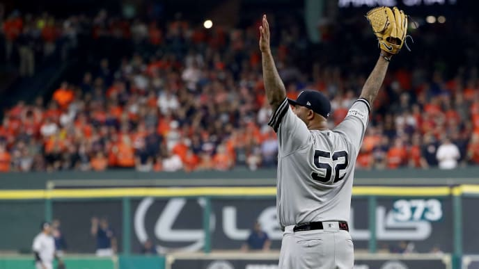 HOUSTON, TX - OCTOBER 21:  CC Sabathia #52 of the New York Yankees reacts after Aaron Judge #99 of the New York Yankees caught a line drive in the outfield hit by Yuli Gurriel #10 of the Houston Astros during the second inning in Game Seven of the American League Championship Series at Minute Maid Park on October 21, 2017 in Houston, Texas.  (Photo by Elsa/Getty Images)