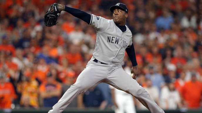 HOUSTON, TEXAS - OCTOBER 13: Aroldis Chapman #54 of the New York Yankees pitches in the ninth inning against the Houston Astros during game two of the American League Championship Series at Minute Maid Park on October 13, 2019 in Houston, Texas. (Photo by Bob Levey/Getty Images)